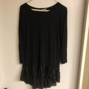 Dylan black top with satin ruffle trim